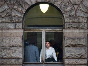 Michelle Kenney, the mother of Antwon Rose II, looks out the courthouse window on the first day of the homicide trial of former East Pittsburgh police officer Michael Rosfeld, Tuesday, March 19, 2019, at the Allegheny County Courthouse, Downtown.