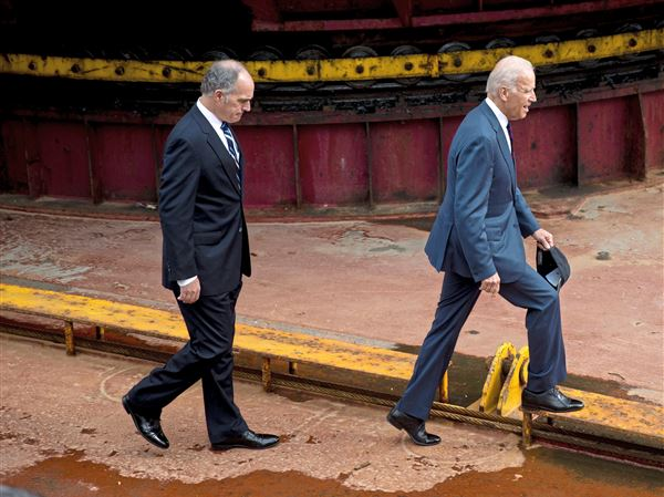 In this Oct. 16, 2014 file photo, Sen. Bob Casey, D-Pa., and Vice President Joe Biden tour a dredging barge at Penn's Landing along the Delaware River in Philadelphia.