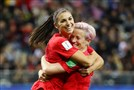Alex Morgan celebrates with teammate Megan Rapinoe after scoring her team's 12th goal against Thailand on Wednesday.