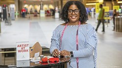 "Tereneh Idia, a Pittsburgh-based fashion designer, is at Pittsburgh International Airport on Monday, June 17, 2019 with items she gives away to passersby who participate in her artist-in-residency program there called ""Wander, Wear, Repeat."""