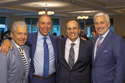 Ben Del Prince, Man of the Year Gennaro DiBello, board president Mark Balistrieri and Dennis Astorino.