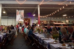 Guests settle in for dinner at the Blessing Board during The Longest Table event on Saturday night in Oakmont.