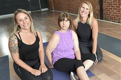 Marissa Vogel, left, of Open Up Pittsburgh with Chelsea Sicheri and Megan Sicheri. Marissa and Megan are co-founders at One Point One Yoga Studio in Garfield.