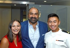 Former Pittsburgh Steeler Franco Harris, center, with Taylor Hajtol, left, and Eddie Zhang, Ensign, U.S. Navy.