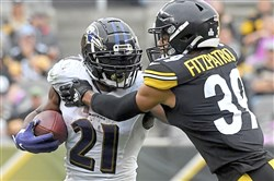 Ravens running back Mark Ingram II carries as he's defended by Steelers safety Minkah Fitzpatrick in the third quarter Sunday, Oct. 6 2019, at Heinz Field.