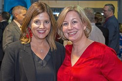 Board Chair Kristen Del Sole Eberle, left, and executive director Laura Maines at the Every Child Inc. murder mystery dinner fundraiser.