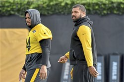 Steelers defensive end Tyson Alualu walks off the field with defensive tackle Cam Heyward during practice Tuesday, Oct. 15, 2019, at UPMC Rooney Sports Complex.