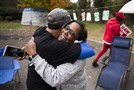Picketing UAW members Richard Rivera, left, and Robin Pinkney react to news of a tentative contract agreement with General Motors in Langhorne, Pa., on Oct. 16, 2019.