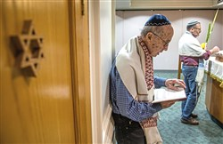 Joe Charny, 91, a survivor from the Tree of Life shooting, reads during a morning minyan prayer service at Congregation Beth Shalom on Wednesday, Oct. 16, 2019, in Squirrel Hill.  Since the Tree of Life synagogue shooting last year Beth Shalom has invited members of Tree of Life, New Light and Dor Hadash to join and lead their daily prayer service.