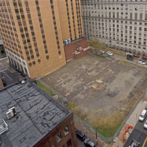 A vacant lot sits directly behind the Grant Building boarding Third and Fourth avenues along Ross Street, Wednesday, Oct. 16, 2019, in Downtown. To the right is the City-County Building.