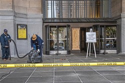 A glass front door to the City-County Building in Downtown Pittsburgh is boarded up after it was found shattered early Thursday, Oct. 17, 2019.