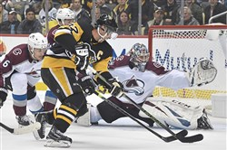 Sidney Crosby beats Colorado goalie Philipp Grubauer on a backhand shot Wednesday, Oct. 16, 2019, at PPG Paints Arena.