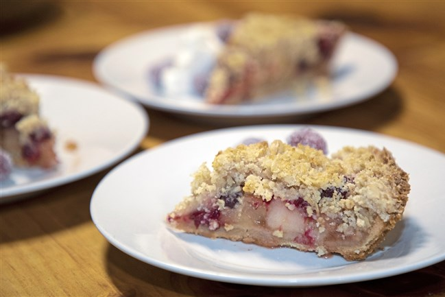 The filling for this Dutch apple pie is made with Gala apples and cranberries and flavored with cinnamon and nutmeg.