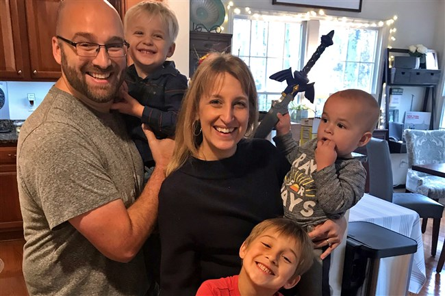 Amy Novak, center, of Hampton is leading an effort to raise money and buy meals for medical workers and first responders in the region. She has the support of, from left, her husband, Vic, and sons Noah, 3; Luke, 7; and Jack, 1.