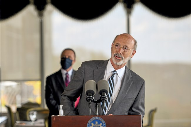 Gov. Tom Wolf announces additional support for the state's restaurant and bar industry during a press conference at the LeMont Restaurant on Mt. Washington on Thursday, Oct. 22, 2020. Behind him is state Rep. Dan Deasy, left, D-West End.
